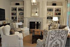 brown  couch, print chair, neutral club chairs