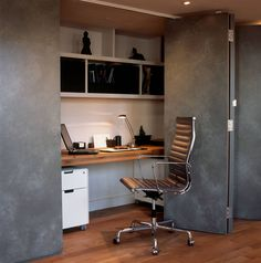 Small Apartment Design Idea - Create A Home Office In A Closet | A long thick slab of wood makes up the desk of this compact home office, which can be quickly hidden when it's no longer in use.