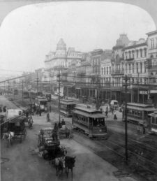 1901 Canal St The Main Thoroughfare of New Orleans. Original Maison Blanche building is the light colored building in the background slightly left of center