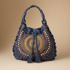 This is a beautiful bag from Sundance. Next time I have a spare $600 laying around, I'll pick it up for me.
