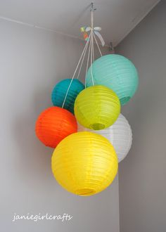 I found this super cute baby mobile on etsy, and I'm going to try to make my own. Paper lanterns are already ordered!