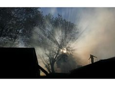 Alex Solano sprays his cousin's mobile home with a garden hose at Mission Mobile Manor in Jurupa Valley. Mobile Home Parks, Riverside County, Sprays, Garden Hose, Outdoor, Outdoors, Rv Parks, Outdoor Games