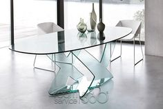 Made in Italy by Tonin Casa. Made entirely of glass, the Oval Ghost table adds the feeling of luxury to your modern dining room. The fine Italian craftsmanship of this table is displayed in the clean lines of the table top and the exquisitely mold. Glass Kitchen Tables, Glass Dining Table Set, Oval Table, Dining Room Table, Table And Chairs, Contemporary Dining Table, Dining Room Furniture, Home Decor, Modern Mansion