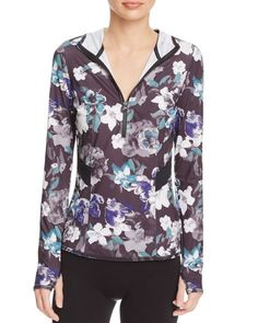 A pretty floral print adds feminine flair to this gym-ready half-zip top from adidas by Stella McCartney. Whether you rock it for your workouts or hanging with the girls, it makes a sporty-chic additi