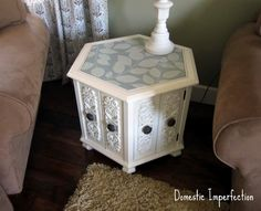 Octagonal 80's table redo w/ a hand painted leaf pattern.