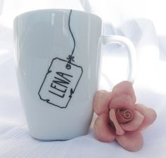 tea tag with the persons name on it - sharpie mug