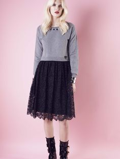 Model wears Naughty Dog double fabric #dress with fleece top decorated with Swarovski elements and black lace skirt.