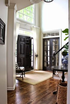 My Sweet Savannah: ~painting interior doors black~note the curtains added on clear rod, and stair rail painted black as well