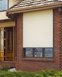 External rolling shutters on a brick home