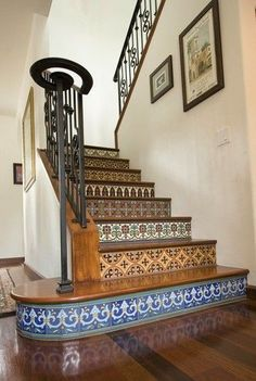 tiled stairs...not sure I like these particular designs but I do like the idea houzz.com: