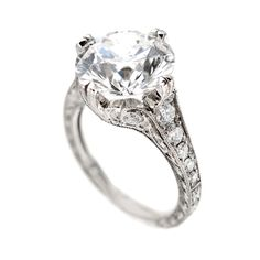 All original Art Deco 1930 to 1940 handmade and hand engraved ring in near perfect condition with it's original early Ideal cut diamond with...