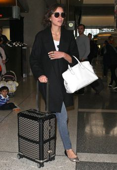 Star Airport Outfits to Copy This Holiday Season: Everybody, take note — Miranda Kerr knows how to fly in style.