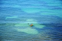 a single boat in the vast ocean - A single boat in the Atlantic Ocean near the Portuguese beach. Atlantic Ocean, Algarve, Portuguese, Portugal, Landscapes, Places To Visit, Waves, Boat, Outdoor