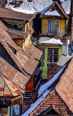 Rooftops with snow in Sighisoara, Transylvania, Romania | by adjafong