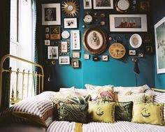 we already have a similar photo gallery in the hall...but i enjoy the clocks and size variations in this Gravity Home, Moody Blues, Guest Bedrooms, Guest Room, Apartment Therapy, Cottage, Space, Living Room, Color