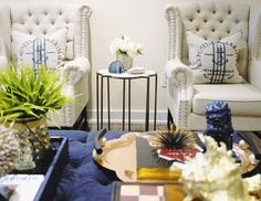 Family room styling with armchairs and marble quatrefoil side table. Tray styling. | Classy Glam Living