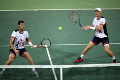 Andy Murray and Jamie Murray Photos Photos - Andy Murray and Jamie Murray of Great Britain in action against Thomaz Bellucci and Andre Sa of Brazil in the mens doubles on Day 2 of the Rio 2016 Olympic Games at the Olympic Tennis Centre on August 7, 2016 in Rio de Janeiro, Brazil. Tennis - Olympics: Day 2
