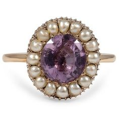 This Victorian-era ring boasts an oval-shaped amethyst surrounded by a halo of natural pearl accents. The yellow gold setting compliments the amethyst with a wonderful splash of color (Amethyst approx. 2.00 total carat weight).