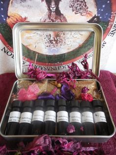 Witches Sabbat Kit: You will receive (8) one dram vials of the oil blends, and (8) 2 x 2 resealable bags filled with the herbal blends for all eight sabbats: Samhain (All Hallow's Eve/Day of the Dead); Yule (Winter Solstice); Impolc (Oimelc); Ostara (Vernal Equinox/Lady Day); Beltane (May Day); Litha (Summer Solstice); Lammas (Lughnasadh); Mabon (Autum Equinox). These will come to you inside the clear window case pictured above, and a brief description of the sabbats is also included.
