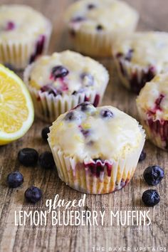 Glazed lemon blueberry muffins - moist, lemony, and full of juicy blueberries. So delicious! www.thebakerupstairs.com