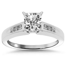 This elegant engagement ring is crafted in 14K white gold. The center is set with one princess cut diamond which weighs 0.62 carats. The side stones consist of smaller princess cut diamonds which total to additional 0.11 carats. Weighing 2.7 grams, this ring is an ideal gift at an affordable value.$1,601.00