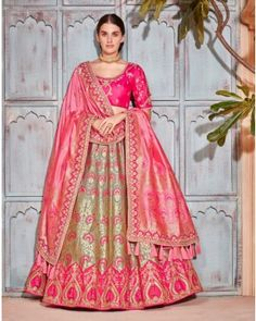 Rich and vibrant- this green jacquard silk lehenga choli is full of life! Designed with traditions at its core, the garment speaks opulence and regalia.Heavy green silk lehenga with cancan layer.Flower designs woven on lehenga with colourful threads and g Banarasi Lehenga, Pink Lehenga, Ghagra Choli, Bridal Lehenga Choli, Lehenga Blouse, Indian Lehenga, Indian Gowns, Pakistani Bridal, Indian Bridal