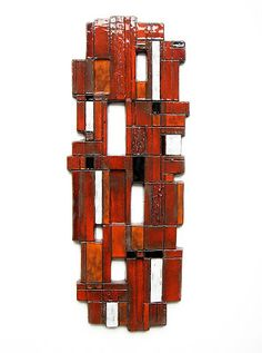 Very large wall sculpture by Oswald Tieberghien. Nice red and orange tones from the 60's..