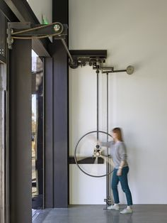 Gallery of 242 State Street / Olson Kundig - 7 242 State Street,Courtesy of Olson Kundig. Image © Bruce Damonte<br> Image 7 of 28 from gallery of 242 State Street / Olson Kundig. Photograph by Bruce Damonte Kinetic Architecture, Architecture Design, Architects Journal, Pivot Doors, Window Wall, Pulley, Door Design, Windows And Doors, Glass Door