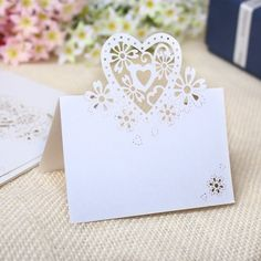 WLM 50Pcs Love Heart Laser Cut Table Name Place Cards Wedding Party Favor Decor (White) WLM http://www.amazon.co.uk/dp/B00ISR02OG/ref=cm_sw_r_pi_dp_.70Xwb0CNSFNG