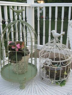 Ideas for cute bird cages...I just created these for my back deck.  Aren't they cute?  BTW, that is a real bird's nest (from last year) in the smaller cage, and I added a bird an plastic eggs.  :)