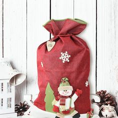 Dressed to impress and ready for the big day the adorable character on the front of our Luxury Festive Red Snowman Sack with Name Tag ensures this is