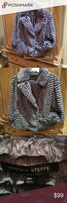 Cynthia Steffe faux fur jacket Cynthia Steffe faux fur gray jacket.  Soft as a blanket.  Worn a couple of times.  No flaws.  Perfect condition.  Reasonable offers will be considered.  No bundle please. Cynthia Steffe Jackets & Coats