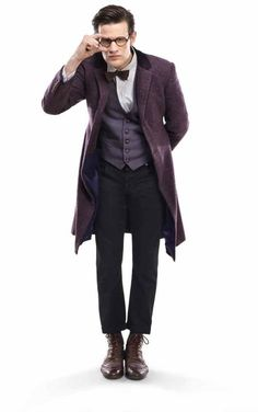 Matt Smith as Doctor Who.  New look for Season 7.  A blue-ish/gray fabric (twead?) with some red flecks and blue waistcoat.  Hmm...different from the Brown tones we saw earlier in the same season.  Costume being altered slightly with Blue tones.  Blue waistcoat along with blue toned victorian/edwardian style coat.  Ever so cleaver incoporating the colors of the TARDIS.