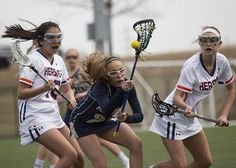 Penn Manor #21 Kalen Blair fighting for the ball.  Hershey Girls Lacrosse defeated Penn Manor 6-5, with deciding point scored by Hershey #20 Tia Smith with 10.4 seconds left on the clock at Hershey High School on Thursday April, 2 2015.  Daniel Zampogna, PennLive