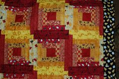 close up of the fabrics on my Egg and I quilt, all chicken related