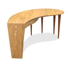 """Windows to the Lagoon Desk $19,100.00 Following on from the """"Abrolhos Collection"""" and inspired by the Windows to the Lagoon Coffee Table, this desk uses swirling featured Marri timber that takes on the effect of the rippling water that you can imagine in an idilic Island lagoon such as at the Abrolhos Islands. Materials: Marri and Sheoak timber with inlay of Mother of Pearl andSheoak. Size: 2000L x 1000W x 760H Custom made to order. Price may vary. Contact us for a quote. - Jah"""