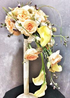 Yellow calla, peach roses & white eustoma waterfall bridal bouquet   For orders & enquiries please email to p01989@yahoo.com.sg or visit our FB myreika13