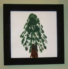 Handprint Christmas Tree by Michelle from A Little Tipsy.