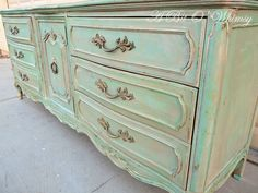 Spray painted gold, then dabbed with Annie Sloan Chalk paint: Provence and Antibes Green Chalk Paint, Then one layer of watered down Annie Sloan Old White, Distress then wax.
