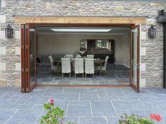 Folding sliding doors by Kloeber Outdoor Tiles, Outdoor Flooring, Indoor Outdoor, Stone Flooring, Concertina Doors, Barn Style Doors, Barn Doors, Tile Steps, Folding Doors