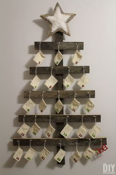 Rustic Advent Calendar. Giant Wall Mounted Advent Calendar perfect for a Rustic Christmas. This DIY advent calendar is over 4 Feet tall. Follow this step by step tutorial so that you can make one for your family! | thediydreamer.com