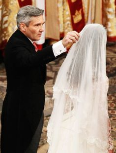 4/29/11 - I love this shot, Michael fixing his daughter's veil for her.