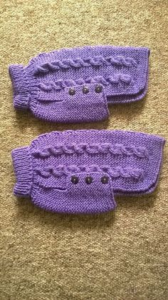 Hand knitted dog jumper in purple with matching buttons. Approx 10 from neck to base of tail and 13 around the chest Can be machine washed and tumble dried on a cool setting.