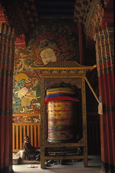 Perpetual turning of a prayer wheel in the Potala Palace in Lhasa, Tibet.    The Tibetan Nuns Project http://tnp.org    Brian Harris Photography http://www.brianharrisphotography.net
