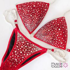 This bright red crystal competition bikini was decorated with red and white/silver color crystals on red fabric.