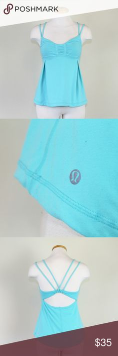 Lululemon Gather Dance Strap Tank Beautiful Angel Blue Gather Dance Strap tank from Lululemon in gently used condition. Made with breathable lightweight luxtreme, this tank was designed to keep you cool and dry during practice. Features low support, built in sport bra, low coverage, and loose flowy design.   Please let me know if you have questions or need more pictures. I will consider all reasonable offers, but no trades, please. lululemon athletica Tops Tank Tops