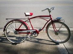"""1961 Columbia Thunderbolt - Restored in 1995 is this flamboyant red 1961 Columbia """"Thunderbolt"""" 26 inch middleweight bike with horn-tank, dual headlites and dual rear reflector rack. Old Bikes, Vintage Bicycles, Columbia, Steel, Retro, Cruiser Bikes, Vehicles, Trailers, Joy"""