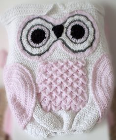 Deidre posted a pic of an Owl cocoon that I just fell in love with and I just had to make it.  This is my crocheted Owl cocoon and I think it turned out very well for the first time doing this pattern.  For those of you who do not know what a cocoon is (don't fret I didn't know what one was either), it's kinda like a sleeping bag for a baby.  You simply slide the child inside the cocoon just like as if you were sliding yourself into a sleeping bag.