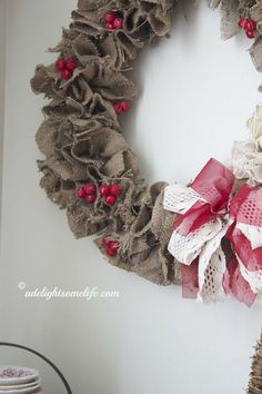 jingle bells spray painted red, grouped together with floral wire add just enough color to the rustic wreath