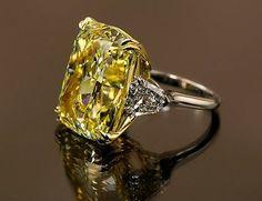 Louis Newman & Co. emerald cut fancy yellow